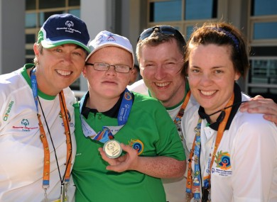 Fergal Gregory, 12, celebrates his gold medal win with coaches