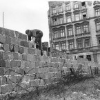 It wasn't long before the Wall was made higher. Here, an East Berlin policeman can be seen putting bricks in place to heighten it to 15ft, or 5m.