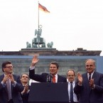 US President Ronald Reagan acknowledges the crowd after his speech in front of the Brandenburg Gate in West Berlin, where he said