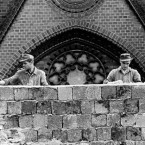Just a couple of weeks after the initial construction, two East German workers put pieces of broken glass on the top to prevent East Berliners from escaping.