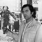 Conrad Schumann, a former member of the East German Army, was the first soldier to escape over the wall into the more free West.   Here, he points at a photograph depicting the moment of his border crossing on August 15, 1961.   This image was taken in 1981 as West German commemorated the 20th anniversary of the wall.