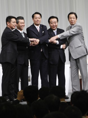 Candidates for the leader of Japan's ruling Democratic Party, from left, Seiji Maehara, Sumio Mabuchi, Banri Kaieda, Yoshihiko Noda and Michihiko Kano, join their hands prior to a debate in Tokyo.