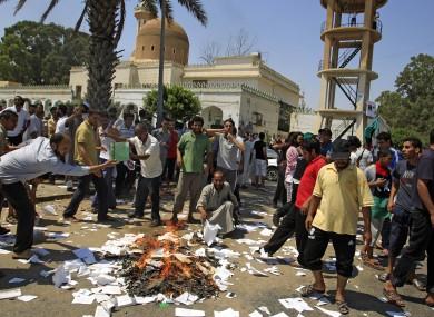Rebel supporters burn Green books in the main square of the Qasr Bin Ghashir district in Tripoli