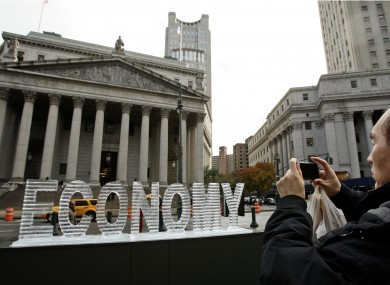 A man takes a photo of an ice sculpture - called 'Melting Main Street' - in New York in 2008.