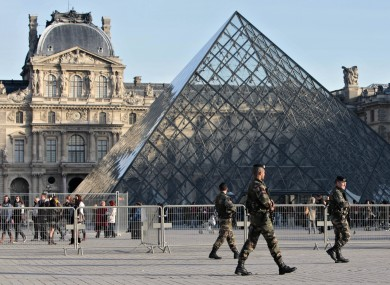 Soldiers patrol in front of the Louvre in Paris after al-Qaeda threatened to target France in October 2010