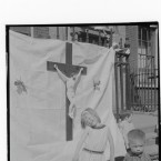 A young girl enjoying the sunshine during the Corpus Christi festival.  Henrietta Street is one of Dublin's oldest wealthy Georgian streets where the buildings later became tenements for the working classes.