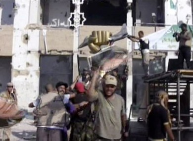 Rebel fighters celebrate taking the compound.