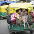 Indian schoolchildren are ferried in an overcrowded auto rickshaw in Ahmadabad, India. (AP Photo/Ajit Solanki)