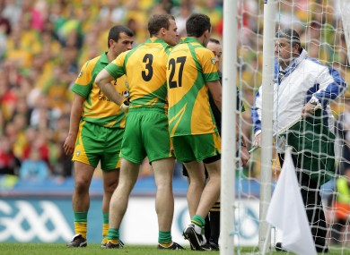 Donegal players surround the umpire last weekend.