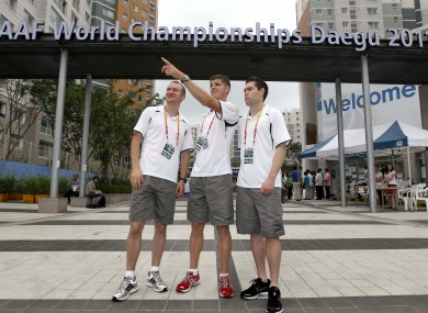 rish athletes Paul Hession (200m), Colin Griffin (50k Walk) and Jason Smyth (100m) relax outside the athletes village in Daegu this week.