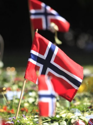 Norwegian flags among flowers and tributes laid outside Oslo Cathedral in memory of the July 22 victims