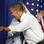 US President Barack Obama hugs Chicago Mayor Rahm Emanuel at a fundraiser on the eve of his 50th birthday on Wednesday night. (AP Photo/M. Spencer Green)