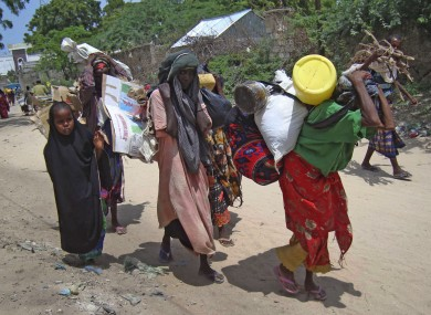 Somalis from southern Somalia carrying their belongings make their way to the refugee camp in Mogadishu