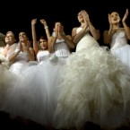 Romanian brides pose for pictures at the Triumph Arch in Bucharest, Romania, a rendezvous place for brides after midnight on the wedding night during the stealing of the bride ritual.To get them back the groom must pay usually money or alcoholic drinks. (AP Photo/Vadim Ghirda)