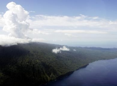 Steam rises from a volcano on the island of Ambae, part of the Vanuatu nation, in 2005. The islands, hit by an earthquake today, sit on the Pacific's Ring of Fire.