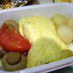 The tomato offers a fleck of colour to this Air Canada breakfast. <span class=