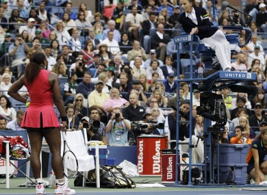 Serena confronts the umpire in New York.