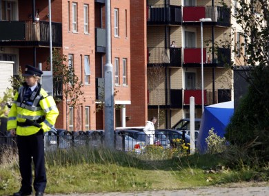 A Garda stands near the forensic tent covering the body of the shot man in Clongriffin today.