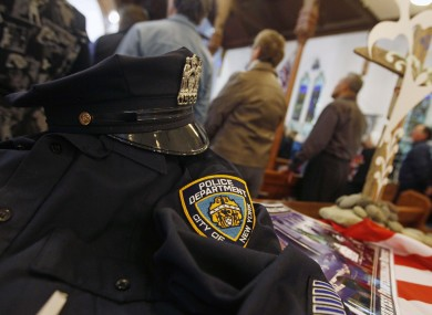 A uniform from the NYPD is displayed during a special service to commemorate the 10th anniversary of the 9/11, at a church in New Plymouth where the USA are playing Ireland in the Rugby World Cup.
