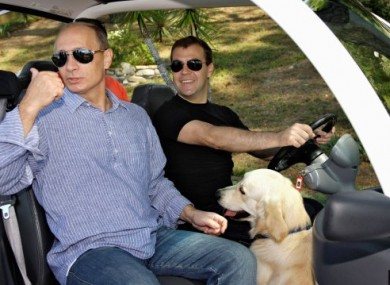 Vladimir Putin, Dmitry Medvedev and Aldo the golden retriever in Sochi, Russia in August 2009.