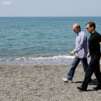 Medvedev and Putin walk at the Bocharov Ruchei presidential residence at the Black Sea resort of Sochi in August 2009. (Dmitry Astakhov/AP/Press Association Images)