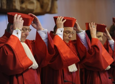 File photo: Members of Germany's Constitutional Court in Karlsruhe put on their hats as they prepare for a day in court.