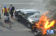Bystanders rescue motorcyclist trapped beneath burning car