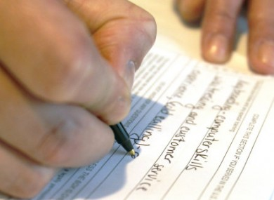 File photo of woman filling in job application.
