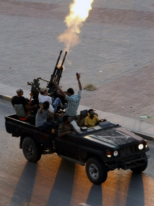 Libyan rebels fire into the air in the Bab El Bahrah district in Tripoli