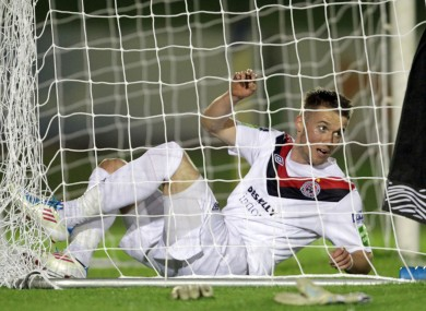 Bohemians' Aidan Downes tries to untangle himself from the net during last night's Premier Division game against UCD. UCD won 2-0.