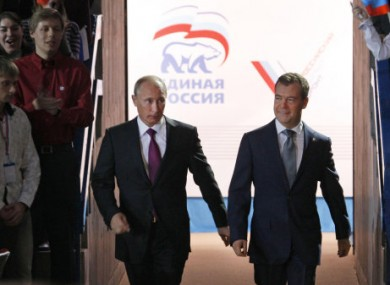 Putin and Medvedev arrive at the United Russia congress in Moscow.