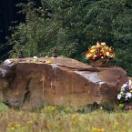 Flowers and small stones are set on a 17-ton boulder which marks the site of the crash of United Flight 93 (AP Photo/Amy Sancetta)