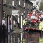 Dublin City Council workers clean blocked drains at Harry's Terrace in Kilmainham. Image: Leon Farrell/Photocall Ireland