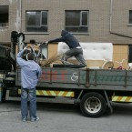 The Fagan family load their bedding and household furniture onto a lorry