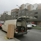 Bedding and furniture being removed from the apartments