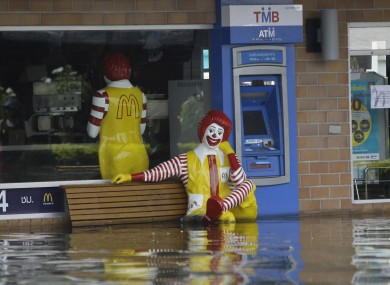 A McDonald's branch partially underwater in Bangkok yesterday