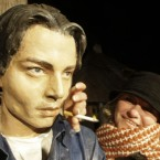 A woman poses with the bust of US actor Johnny Depp in the village of Drvengrad in south Serbia.   Depp once opened a film and music festival there and was honoured with the statue.   Image: AP Photo/Darko Vojinovic