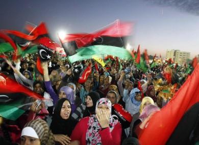 Libyans celebrate at Saha Kish Square in Benghazi, Libya, yesterday