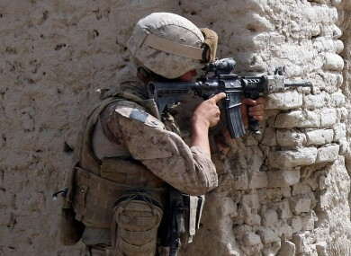 A US Marine serving in Afghanistan. A military court has ruled that it is permissible to wear some items of a military uniform while filming pornography.