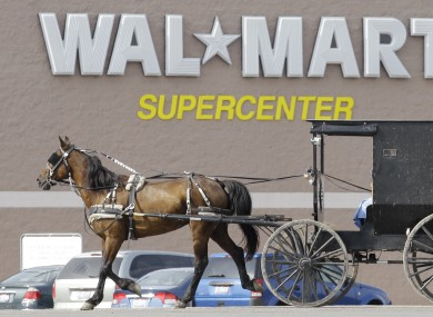 An Amish buggy drives away from a Wal-Mart store in Ohio.