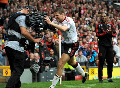 Liverpool's Steven Gerrard hugs a TV camera at Old Trafford in 2010. An ECJ ruling could have major implications for the lucrative TV rights that propel the Premier League.