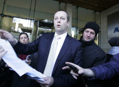An Aviva spokesperson hands out copies of a press release outside its Dublin offices in the wake of Wednesday's jobs announcement.