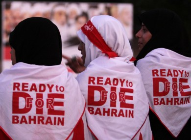 Bahraini anti-government protesters attend a rally of thousands organized by Al-Wefaq, the largest Shiite opposition party, to demand greater freedoms