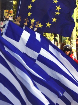 The Greek and EU flags on sale this week in Athens