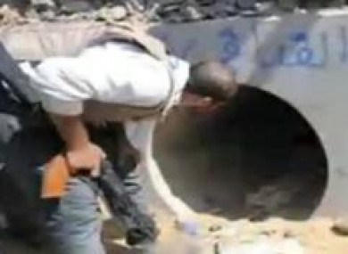 The hole where Gaddafi was reportedly captured by NTC forces in Sirte today.