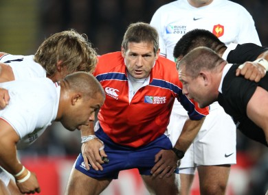 Alain Rolland keeps a close eye on the France and New Zealand front rows.