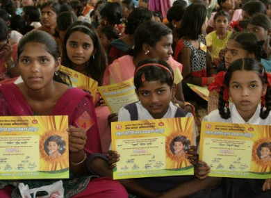 Girls hold certificates stating their new official names during a renaming ceremony in Satara, India,