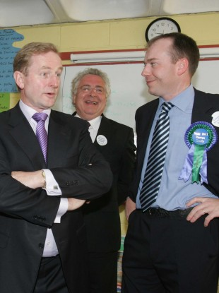 Leader Enda Kenny TD with school children in Kill National School in Kill County Kildare, on day two of the General Election 07. Left to right. Enda Kenny, and North Kildare candidates Bernard Durkan TD and Cllr Darren Scully.
