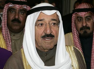 Kuwait's Sheikh Sabah Al Ahmed Al Sabah, followed by two aides