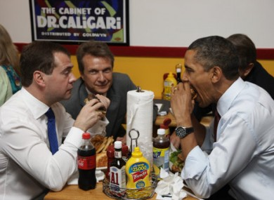 File photo of Medvedev and Obama enjoying burgers together in Virginia, US last year.